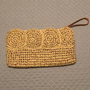 NWOT Woven/straw clutch with gold detail